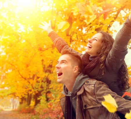 Happy Couple in Autumn Park  Fall  Family Having Fun Outdoors