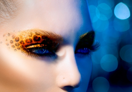 Beauty Fashion Model Girl with Holiday Leopard Makeup Stock Photo - 22783584