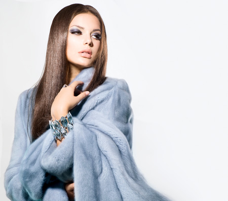 Beauty Fashion Model Girl in Blue Mink Fur Coat