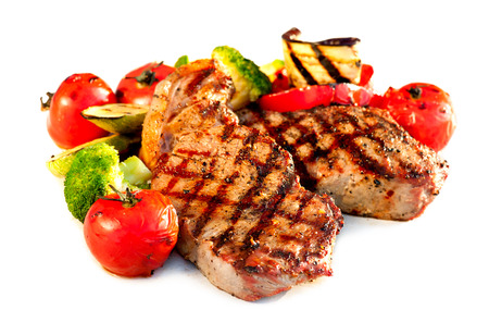 medium close up: Grilled Beef Steak with Vegetables over White Background  Stock Photo
