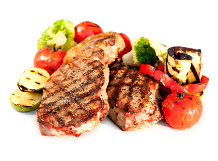 Grilled Beef Steak with Vegetables over White Background  Stock Photo - 23246687
