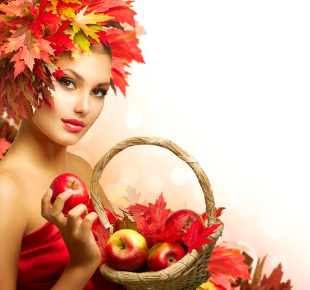 Beauty Autumn Woman with Ripe Red Organic Apples  photo
