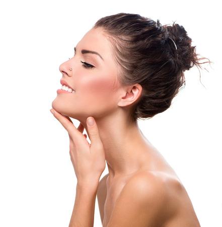 woman profile: Beauty Portrait  Beautiful Spa Girl Touching her Face