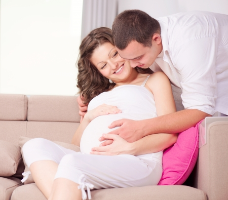 Beautiful Pregnant Woman and Her Husband Expecting Baby  photo
