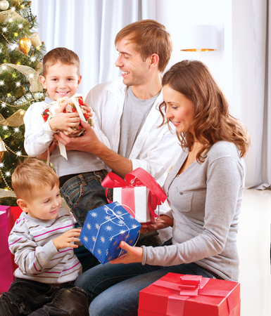 Christmas Family  Children Opening Gifts  Christmas tree  Stock Photo - 23419407