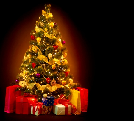 Christmas Tree with Gifts isolated on black background  photo