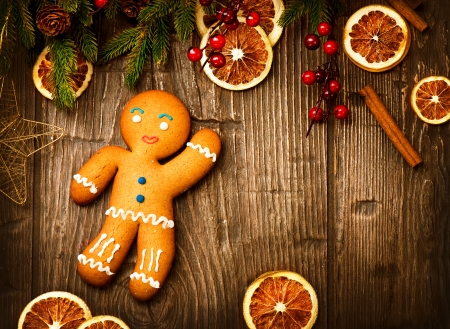 Gingerbread Man over Wood  Christmas Holiday Background  photo