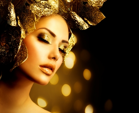 beautiful face: Fashion Glamour Makeup  Holiday Gold Make-up  Stock Photo