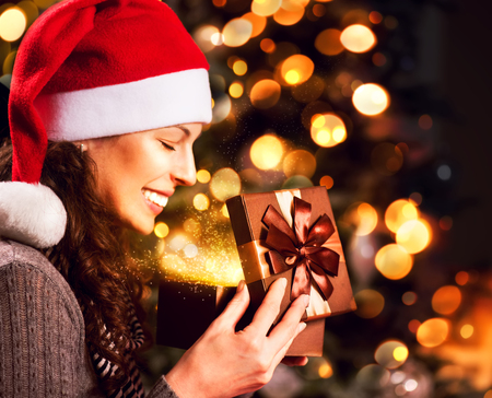 Christmas Gift  Happy Surprised Woman opening Giftbox  photo