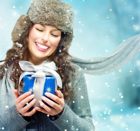 Beautiful Young Woman with Christmas Gift Box Surprised Girl
