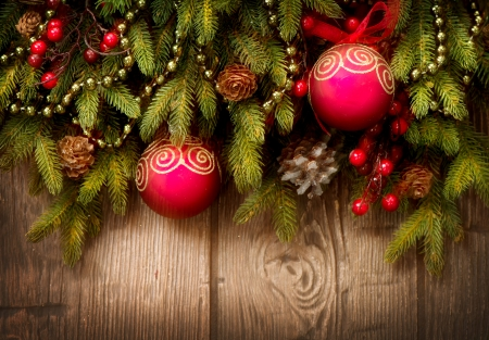 Christmas Tree and Decorations Over Wooden Background photo