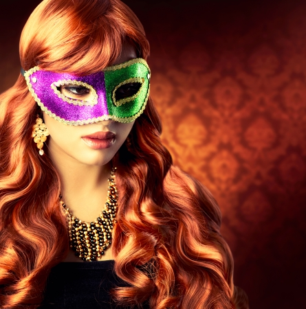 Beautiful Girl in a Carnival mask Stock Photo - 23961187