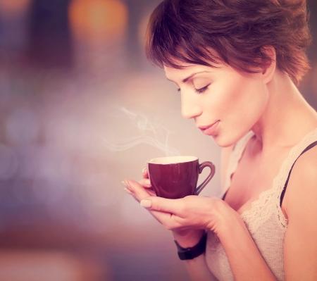 Coffee  Beautiful Girl Drinking Tea or Coffee Фото со стока - 23961190