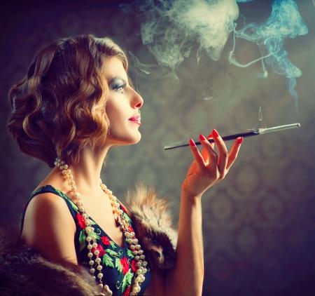 Lady: Retro Woman Portrait  Smoking Lady with Mouthpiece Stock Photo