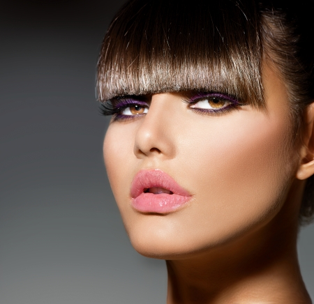 short cut: Fringe  Fashion Model Girl With Trendy Hairstyle and Makeup Stock Photo