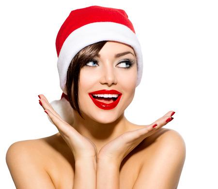 美女: 聖誕女人美容型號女孩在聖誕老人的帽子