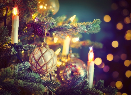 Christmas Tree Decorated with Baubles, Garlands and Candles photo