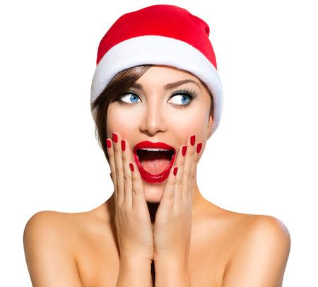 make a gift: Christmas Woman  Beauty Model Girl in Santa Hat over White Stock Photo