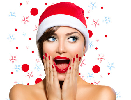 Christmas Woman  Beauty Model Girl in Santa Hat photo