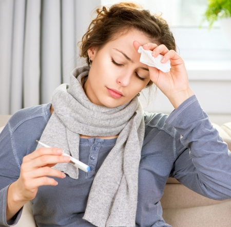 Sick Woman with Thermometer  Headache photo