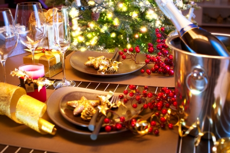 plate setting: Christmas And New Year Holiday Table Setting with Champagne