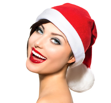 Christmas Woman  Beauty and Sexy Model Girl in Santa Hat photo