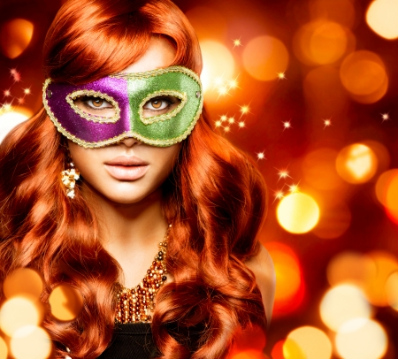 Beautiful Girl in a Carnival mask Stock Photo