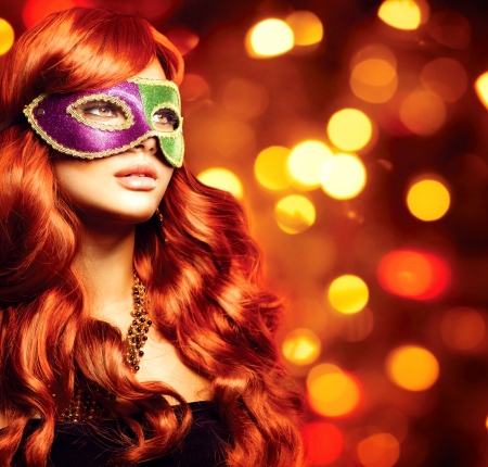 Beautiful Girl in a Carnival mask photo