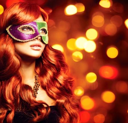 Beautiful Girl in a Carnival mask Stock Photo - 24331826