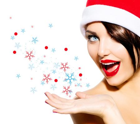 Kerstmis Vrouw Schoonheid Meisje in Santa hoed geïsoleerd op wit