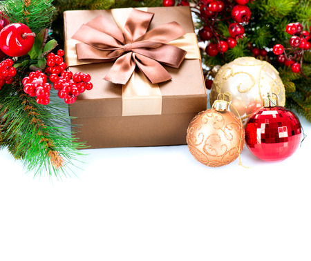 Christmas Decorations and Gift Box Isolated on White photo