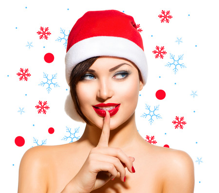 Christmas Woman  Beauty Model Girl in Santa Hat over White photo