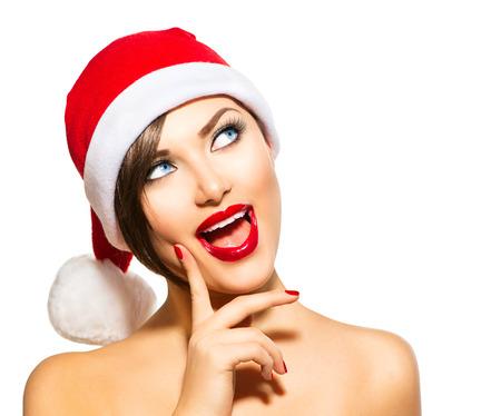 美女: 聖誕女人美容型號女孩在聖誕老人的帽子在白色