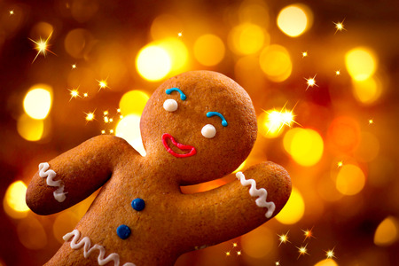 Christmas  Gingerbread Man over Glowing Holiday Background photo