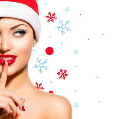 christmas manicure: Christmas Woman  Beauty Model Girl in Santa Hat over White Stock Photo