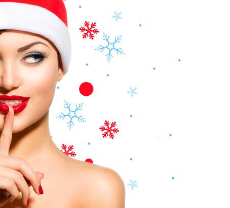 Christmas Woman  Beauty Model Girl in Santa Hat over White Stock Photo