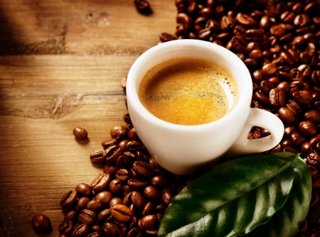 Coffee Espresso  Cup Of Coffee with Beans and Green Leaf Stock Photo