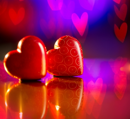 Couple of Valentines Red Hearts over Abstract Purple  photo
