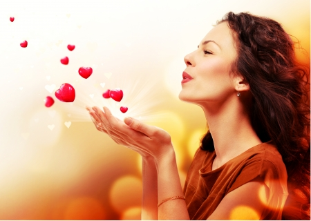 woman blowing: Woman Blowing Hearts from her Hands  St  Valentines Day Concept