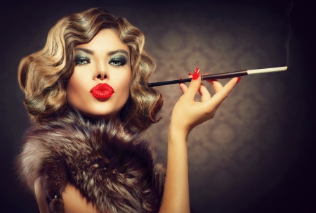 Beauty Retro Woman with Mouthpiece  Vintage Styled Beauty photo