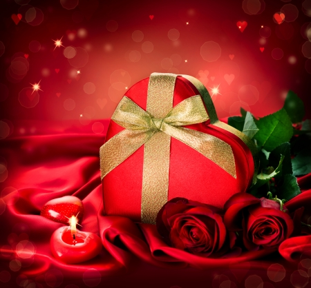 Valentine Red Hear Gift and Red Rose Flower over Red Silk photo