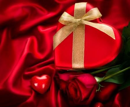 Valentine Red Hear Gift on Red Silk Background photo