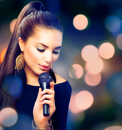Beautiful Singing Girl  Beauty Woman with Microphone photo