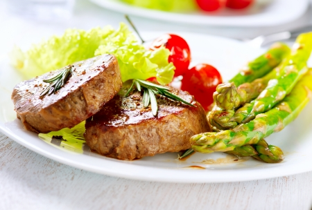 Grilled Beef Steak Meat with Asparagus and Cherry Tomato photo