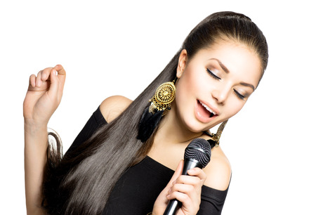 Singing Woman  Beauty Woman with Microphone photo