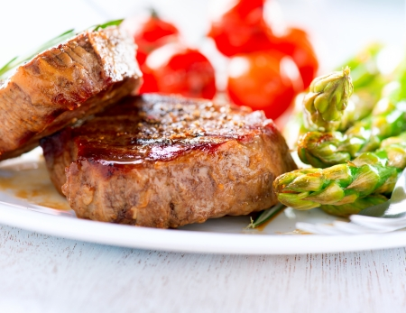 Steaks  Grilled Beef Steak Meat with Vegetables photo