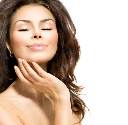 woman blowing: Beauty Woman  Beautiful Young Female touching Her Skin Stock Photo
