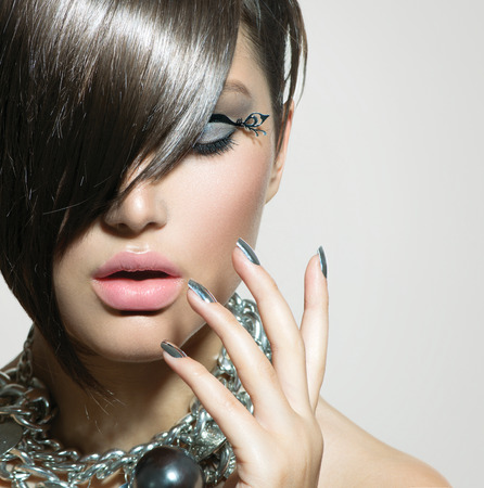 Fringe  Beauty Sexy Model Girl with Perfect Makeup and Manicure photo