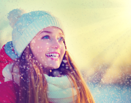 cold season: Beauty Winter Girl Having Fun in Winter Park  Stock Photo