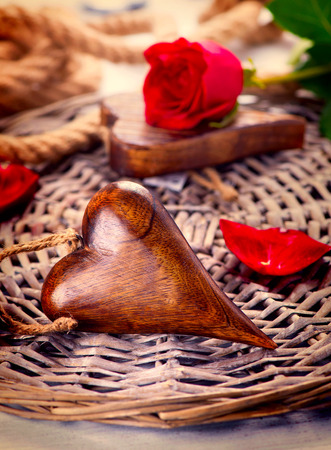 Valentine s Day  Wooden heart over wood background  photo